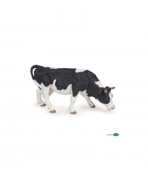 Vache noire et blanche broutant Papo